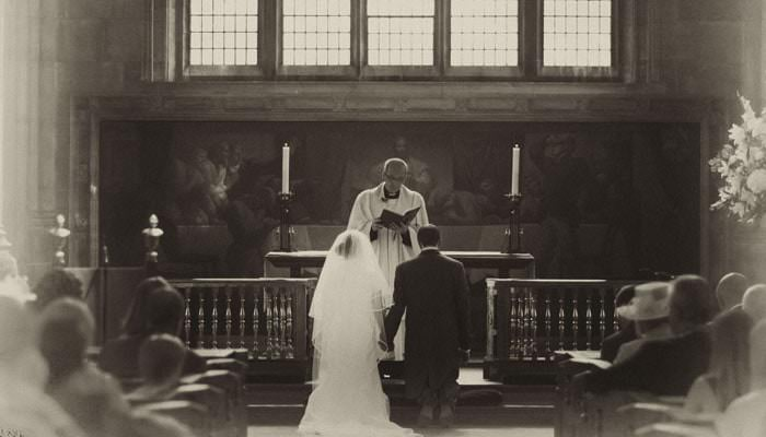 Wedding photograph of Emma and Steven in church service