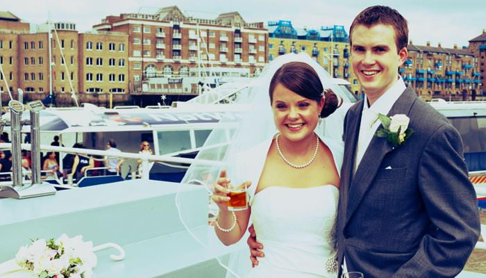 Wedding photograph of Emma and Steven on boat trip down Thames