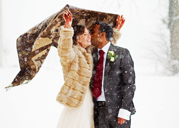 Wedding Photograph of Couple in Snow at Heythrop Park Hotel, Oxfordshire