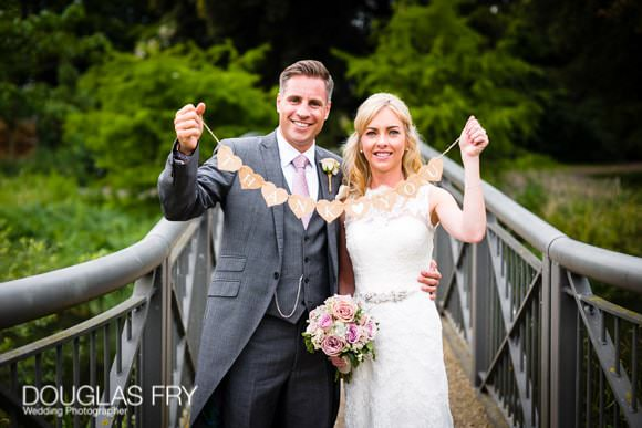 Wedding Photograph of couple holding thank you sign