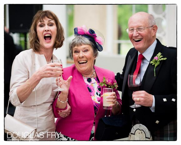 Guests enjoying themselves in the Great Conservatory Syon Park during the wedding reception