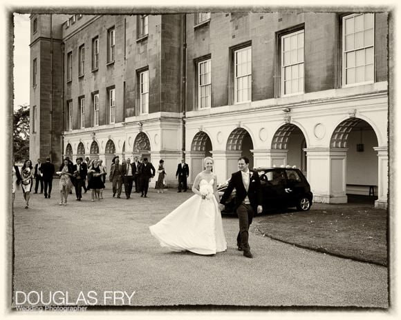 The couple and guests walking to the Great Conservatory at Syon Park