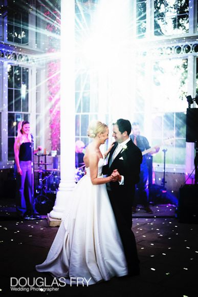 Bride and groom dancing - photographed in Great Conservatory at Syon Park