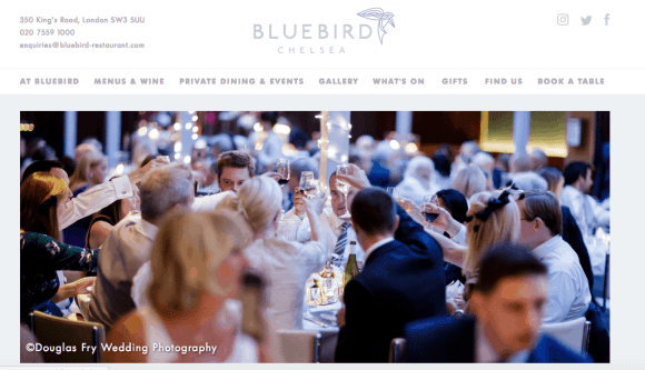 Photograph of guests seaed during wedding breakfast at Bluebird in London