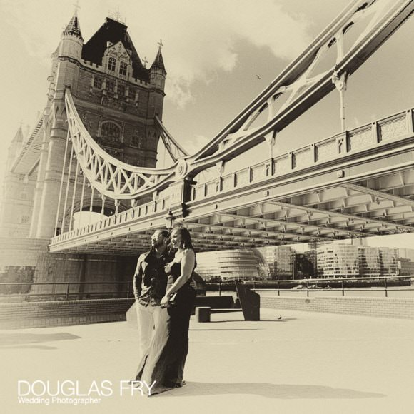 Photography of couple in front of Tower Bridge in London