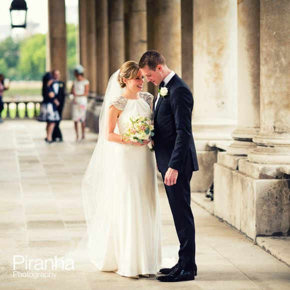 Wedding photograph of bride and groom talking outside Admirals House, Old Royal Naval College in Greenwich