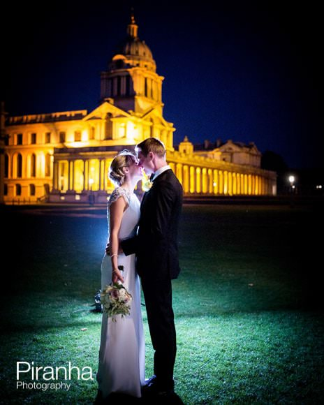 Bride and groom photographed illuminated outside the Old Royal Naval College in Greenwich