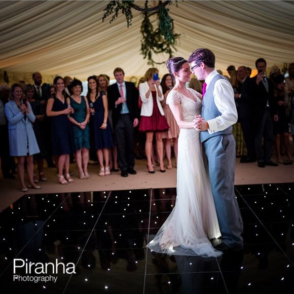 Dancing photograph of bride and groom in marquee