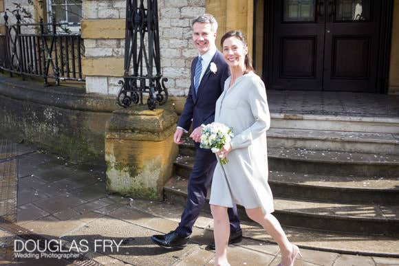 Bride and groom wedding photograph as they walk away from Oxford Register Office