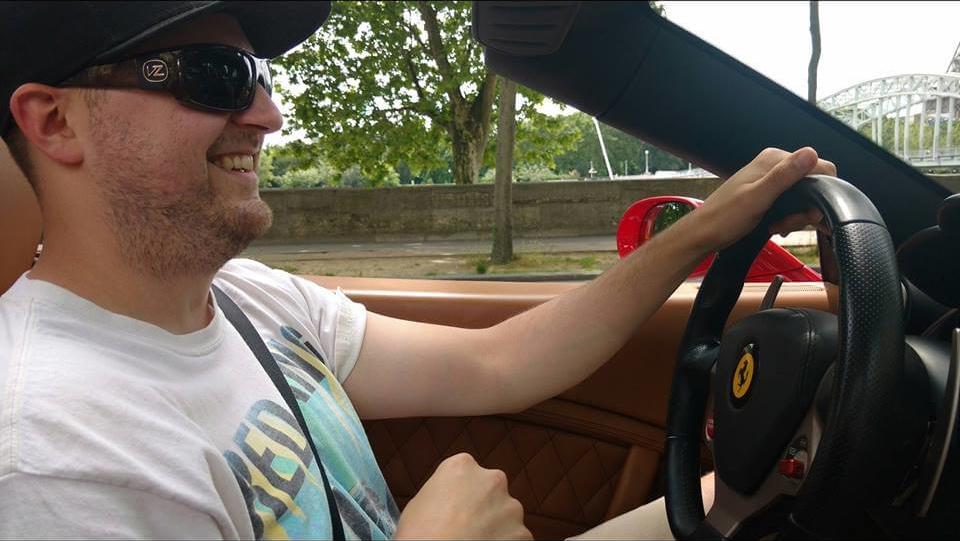 J-D driving a Ferrari in Paris.