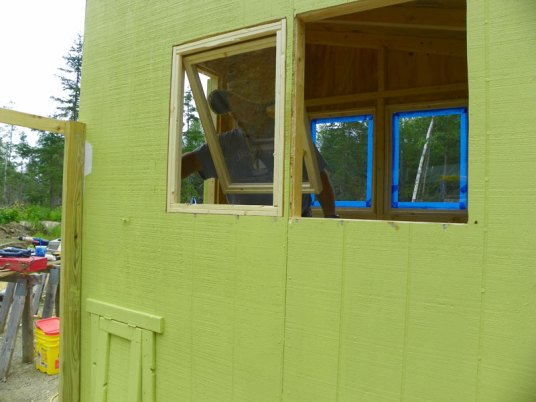 Chicken coop windows going in