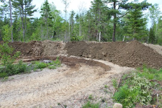 The mountain of clay excavated from the pond