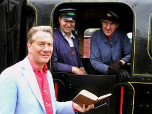 Michael Portillo with engine driver Jeff Spencer and fireman Robert Edwards, examining what Bradshaw has to say about Downpatrick