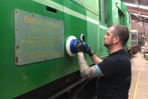 DCDR volunteer Innis Mennie starts work on cleaning and polishing the outside of the TPO.