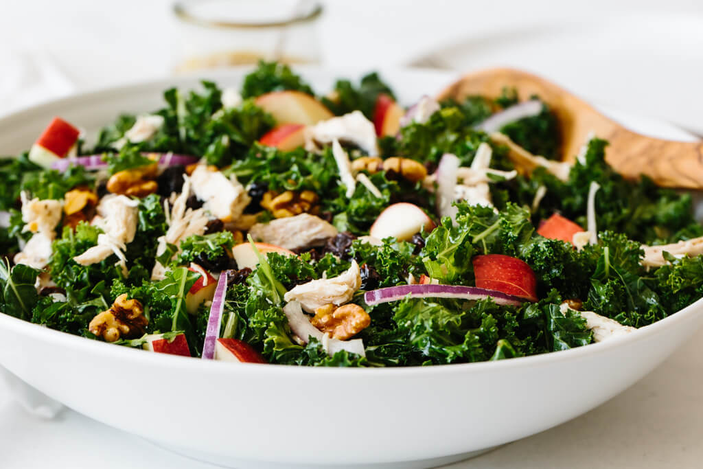Kale salad drizzled with apple cider vinaigrette.