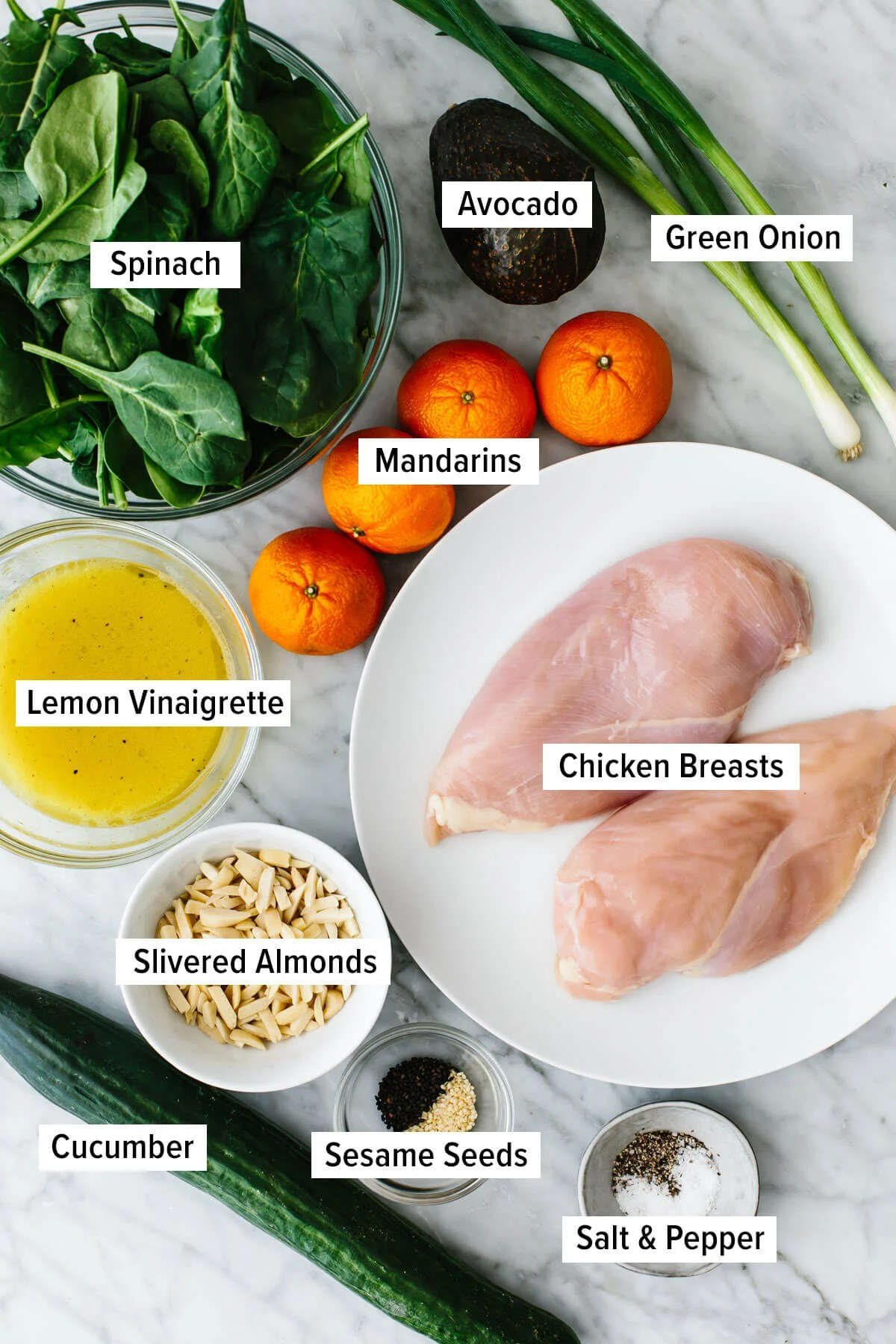 Ingredients for mandarin chicken salad on a table.