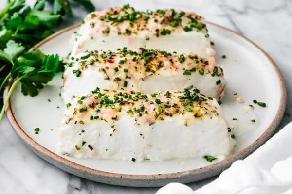 Baked halibut fillets with an herbed mayonnaise crust.