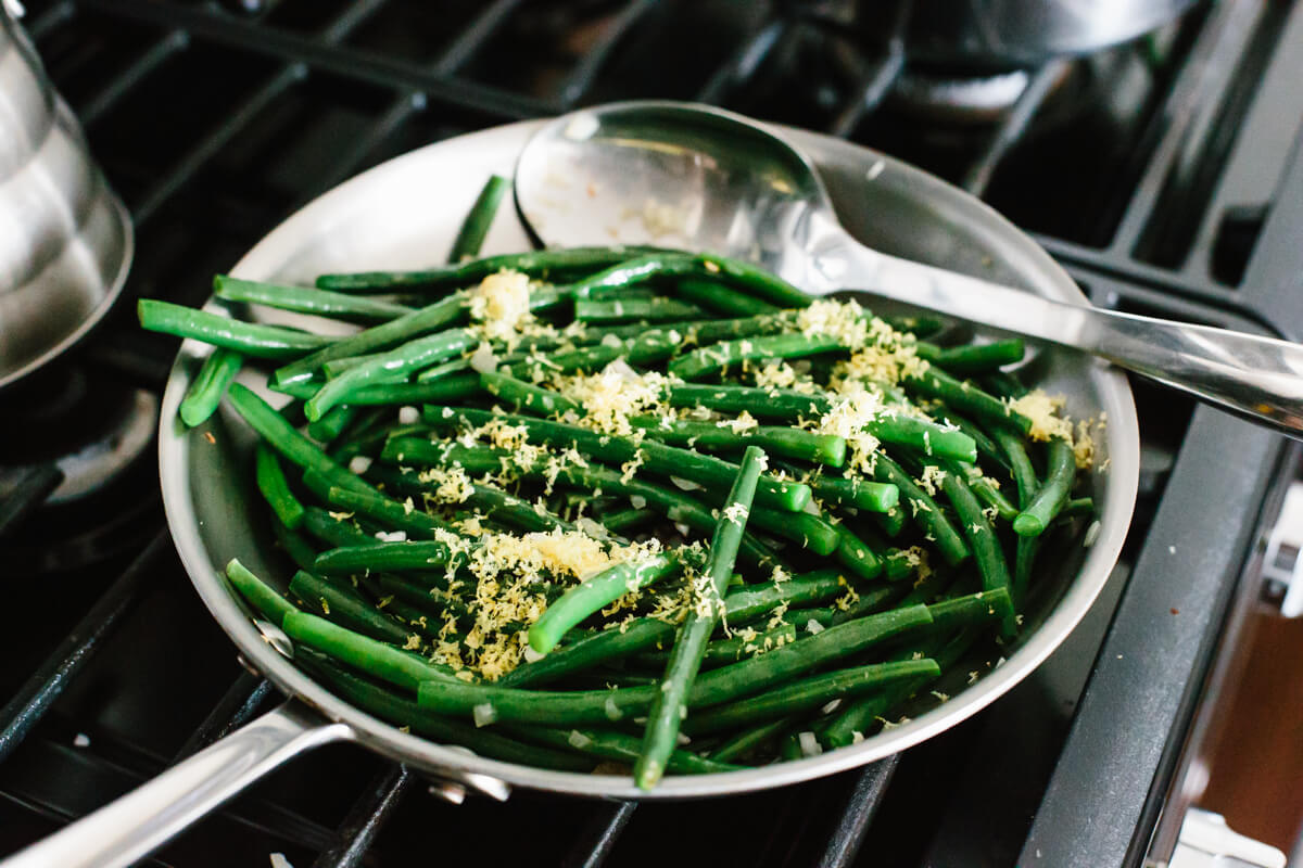 Sauteeing green beans with lemon and shallots.