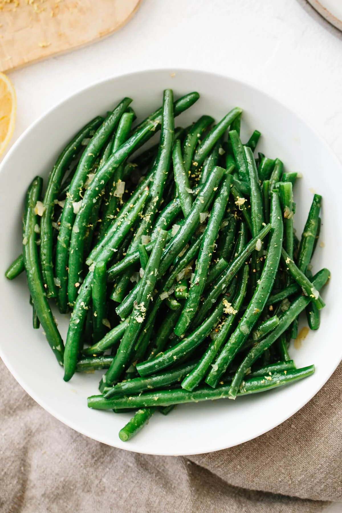 Green beans in a white bowl.