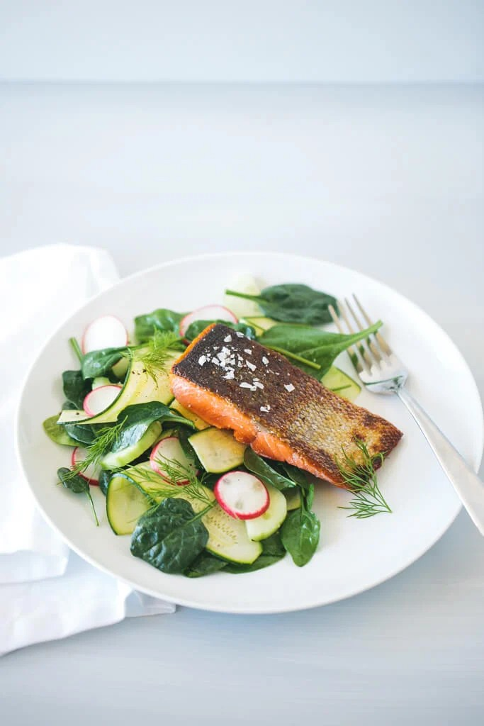 crispy skin salmon on zucchini cucumber salad
