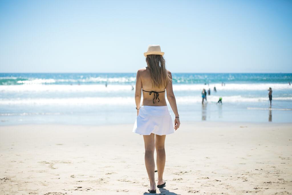Girl walking along the beach.