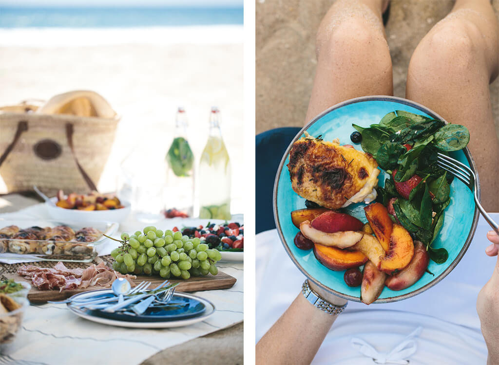 A beach picnic with a plate full of food.