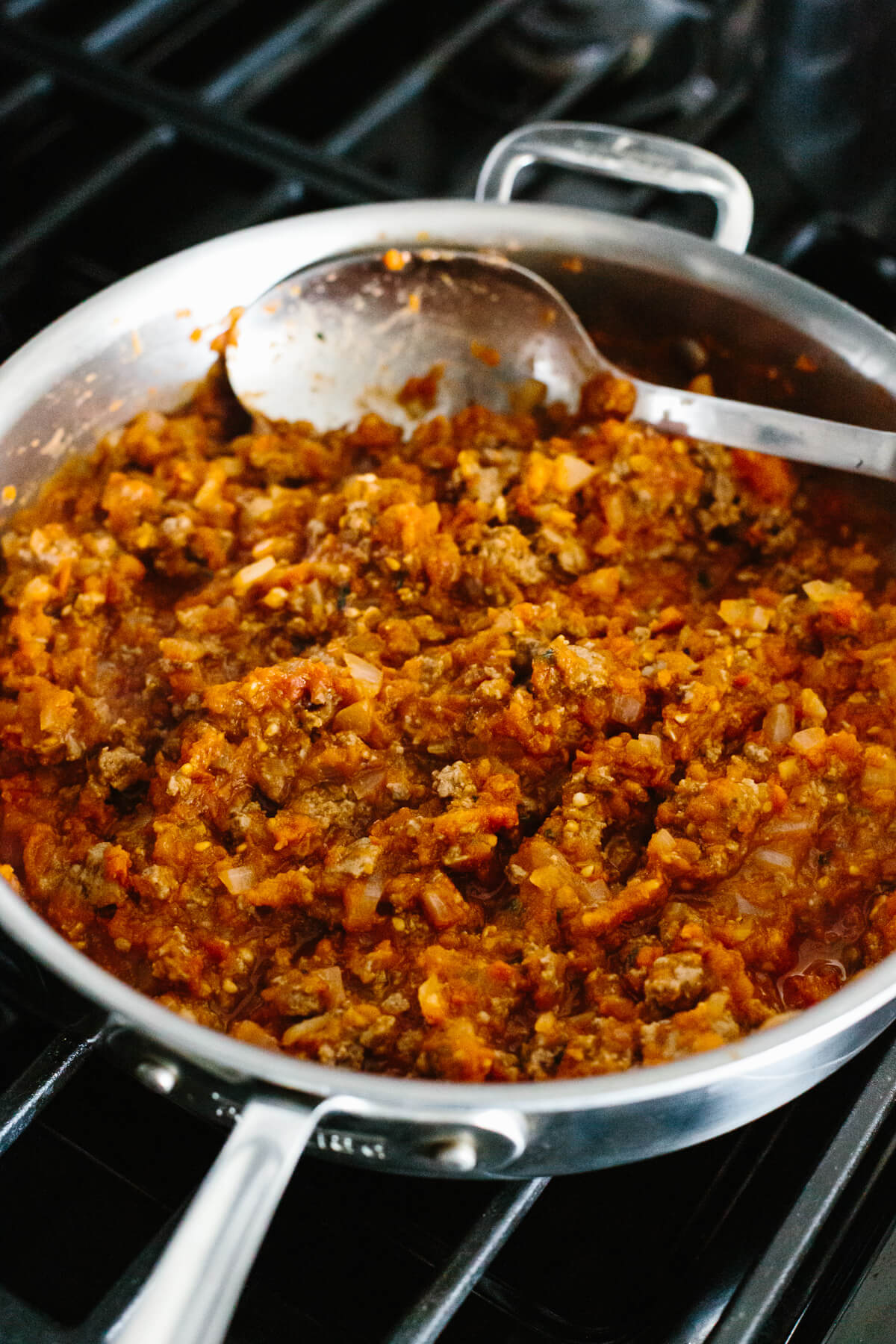 Bolognese sauce in a pan on the stove.