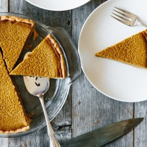 A slice of paleo pumpkin pie on a plate.