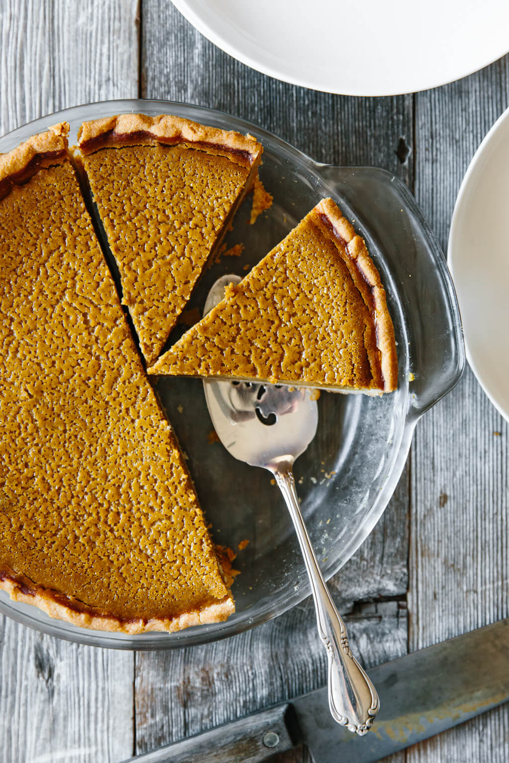 This Paleo Pumpkin Pie is creamy and delicious with a perfectly golden and flaky crust. It's gluten-free, dairy-free and refined sugar-free.