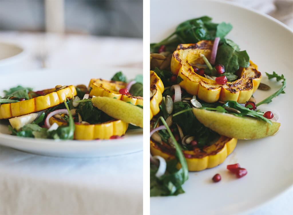 A healthy, roasted delicata squash, pear and pomegranate salad. The perfect seasonal salad recipe that's gluten-free, paleo and vegan.