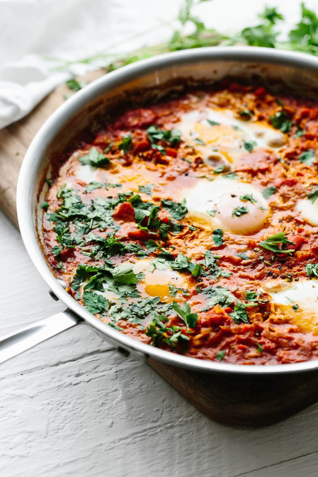Shakshuka is an easy, healthy breakfast recipe in Israel and other parts of the Middle East and North Africa. It's a simple combination of simmering tomatoes, onions, garlic, spices and gently poached eggs.