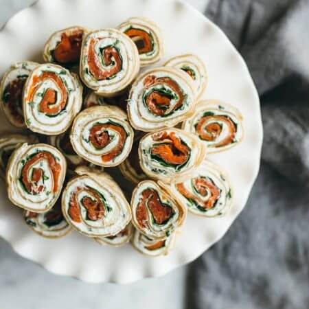 (gluten-free, paleo) Herbed Chevre, Spinach and Smoked Salmon Pinwheel. A tasty appetizer or snack made with cassava flour tortillas.