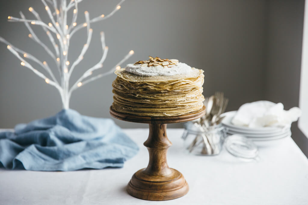 Coconut amaretto crepe cake. It's gluten-free, grain-free and refined sugar free and made with cassava flour crepes. Paleo-friendly.