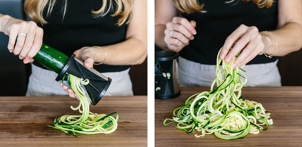 Making zucchini noodles with a handheld spiralizer.