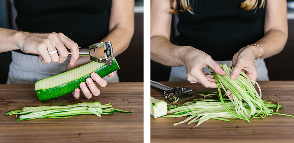 Making zucchini noodles with a julienne peeler.