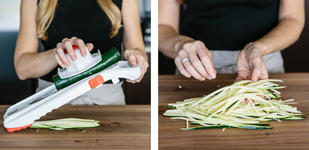 Making zucchini noodles with a mandoline.