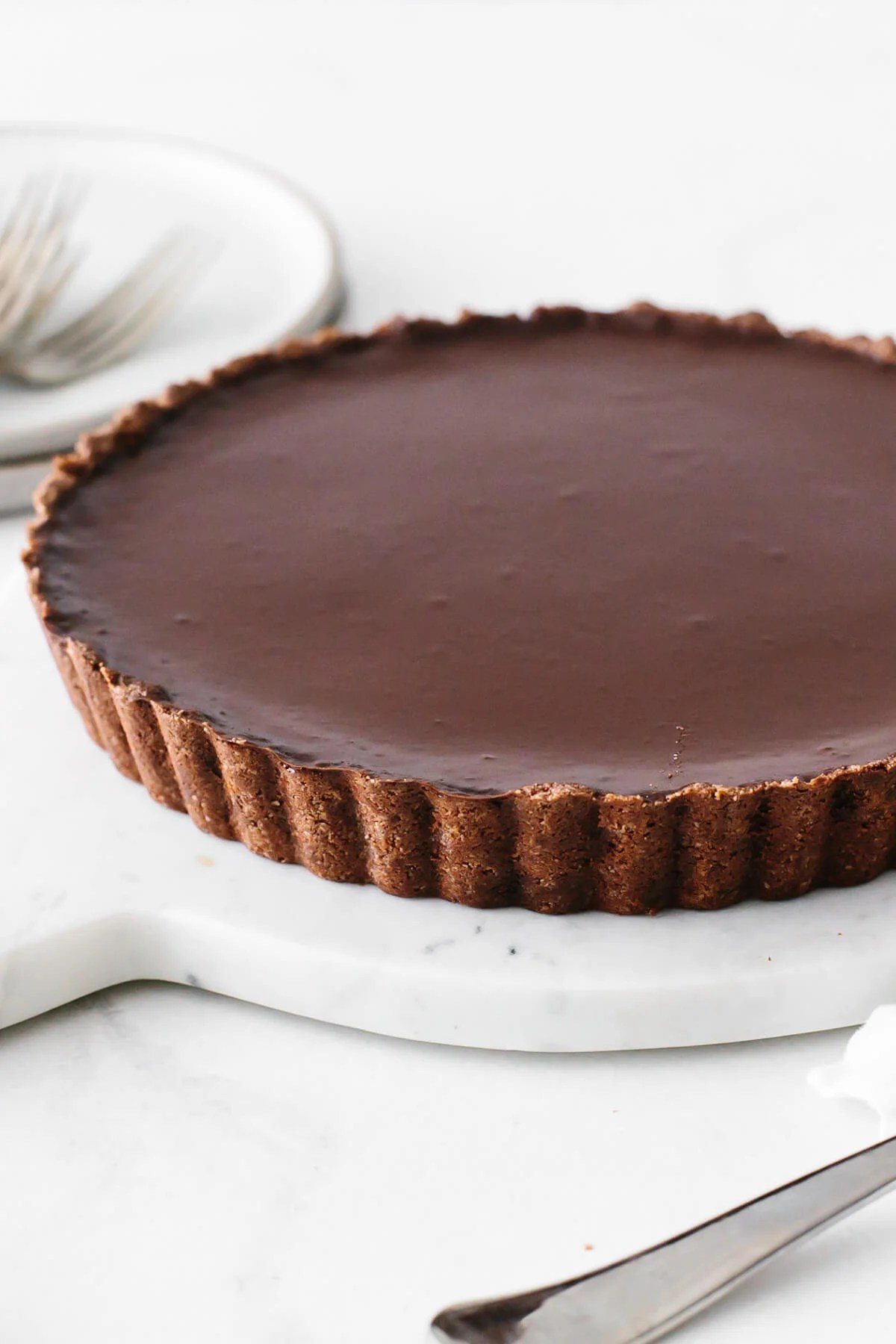 Chocolate tart recipe on a serving platter.
