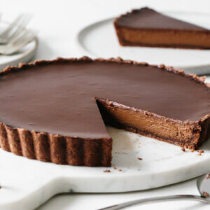 A slice cut from the chocolate tart recipe.