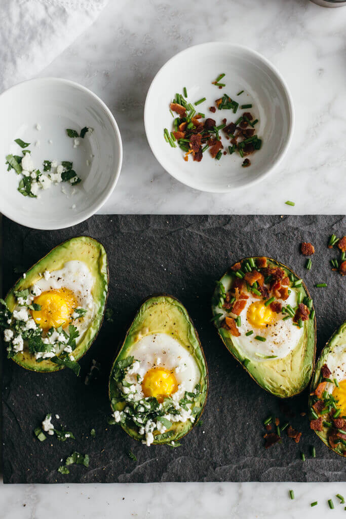 Baked eggs in avocado. A perfect gluten-free, paleo breakfast.