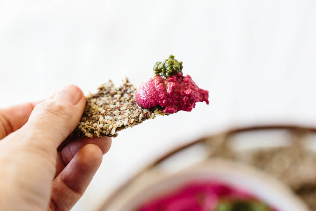 Beet hummus is made with oven roasted beets, chickpeas, tahini, olive oil, lemon juice and garlic. It's a vibrant and healthy snack or appetizer recipe.