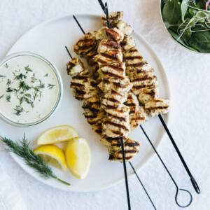 Grilled chicken souvlaki (lemon garlic chicken skewers) with dairy-free tzatziki. Gluten-free and paleo.