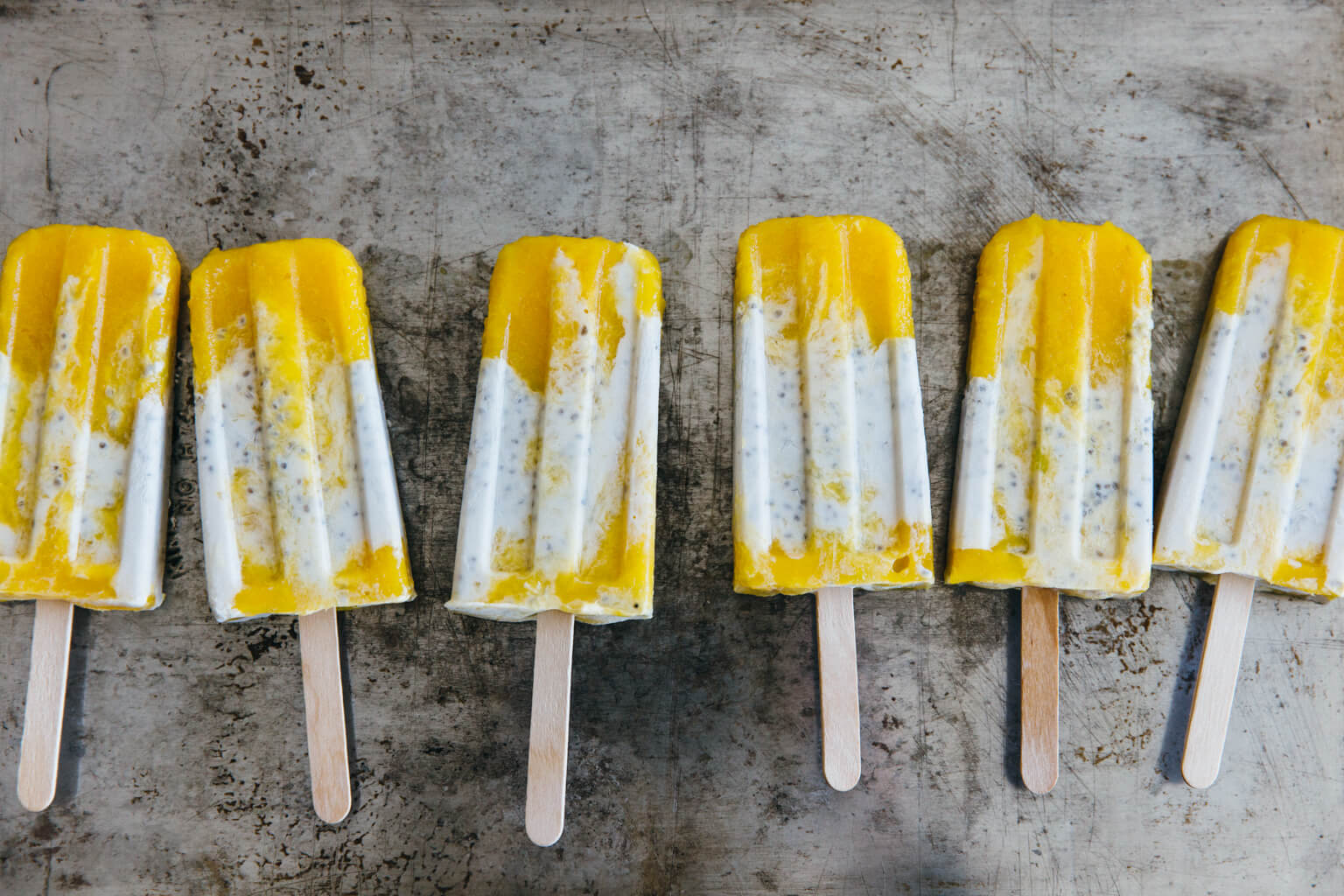 Coconut chia mango popsicles. Dairy-free and refined-sugar free.
