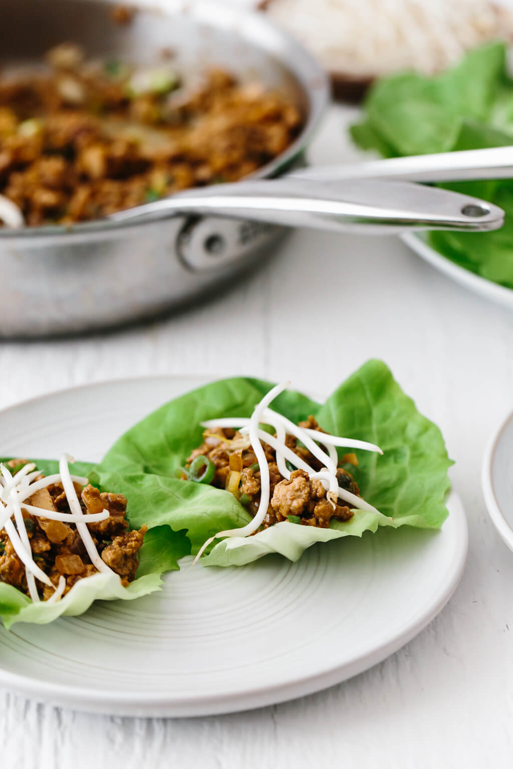 These Asian Chicken Lettuce Wraps are reminiscent of PF Chang's Chicken Lettuce Wraps, yet they're gluten-free, paleo and much healthier. It's a family favorite chicken dinner recipe.