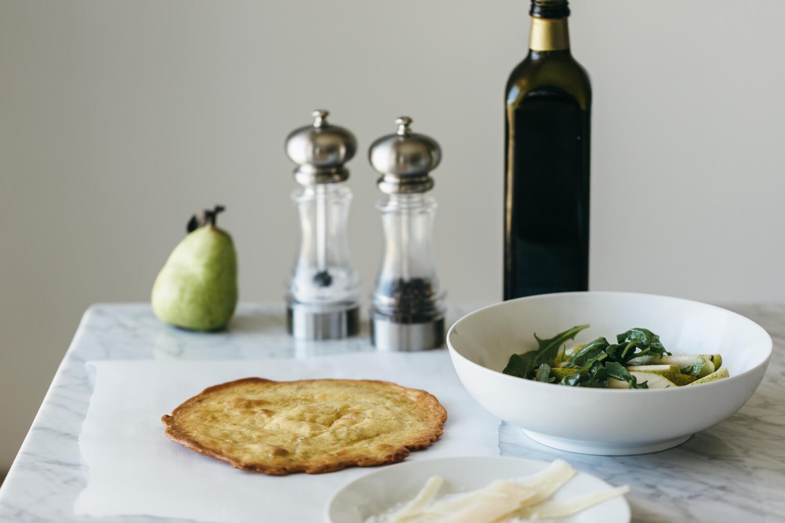 Crispy socca with pear and arugula salad. Gluten-free, grain-free, paleo.