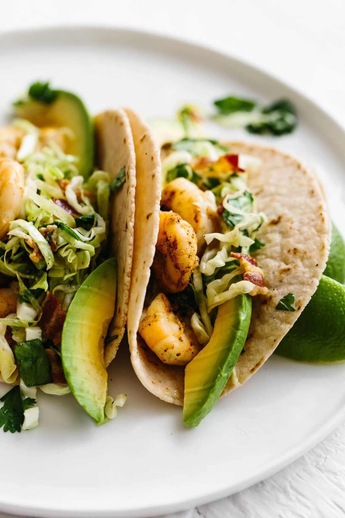 Shrimp taco recipe on a plate.