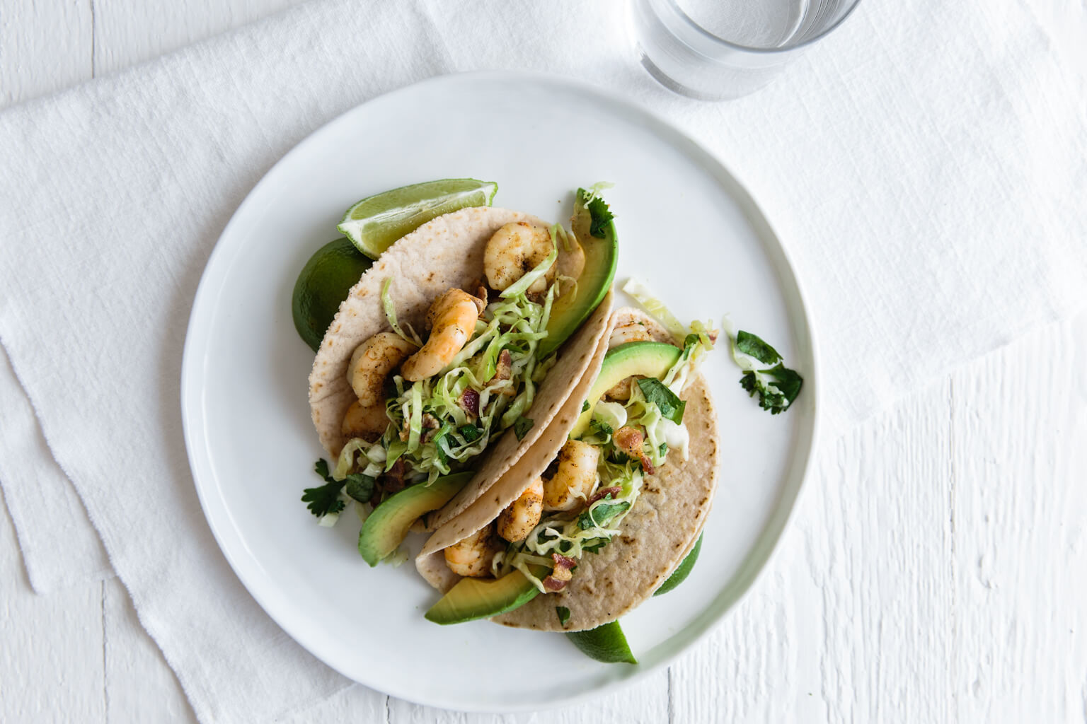 Shrimp Tacos with Cilantro, Lime, Bacon Slaw. Gluten-free and paleo.