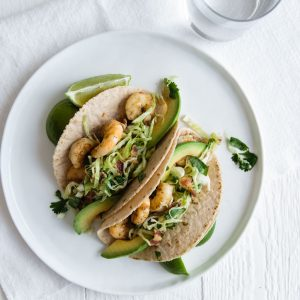 (gluten-free, paleo) Shrimp Tacos with Cilantro, Lime, Bacon Slaw. These chipotle shrimp tacos are made with cassava flour tortillas for a healthy, gluten-free, Taco Tuesday favorite!