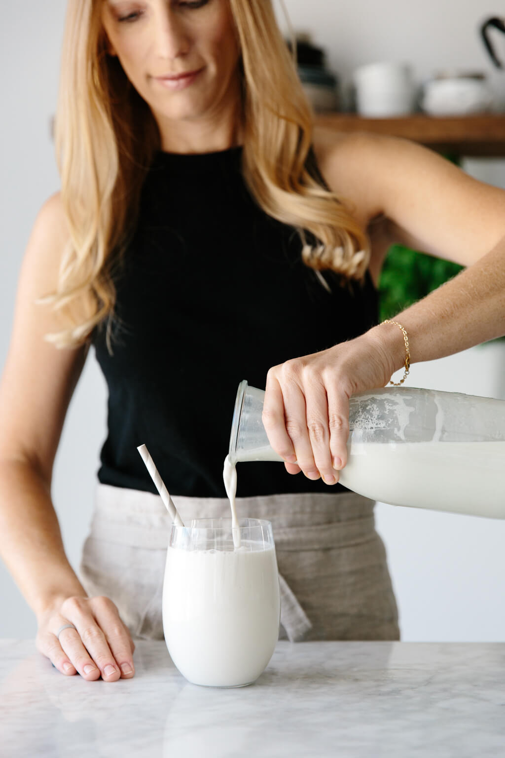Cashew milk being poured into a glass