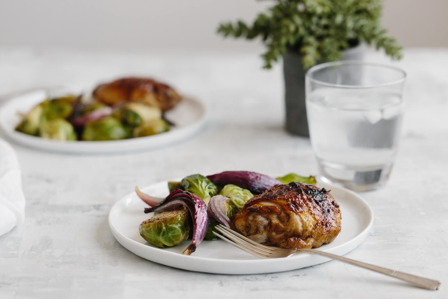 (gluten-free, paleo) Roasted balsamic chicken and brussels sprouts. An easy, healthy, one pan recipe that's sure to be a family favorite.