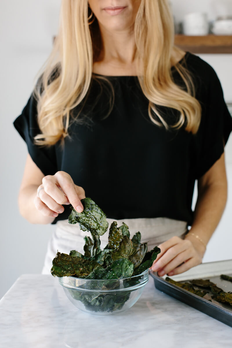Kale chips are the perfect healthy snack and easily satisfy any salty or savory craving. They're light, crispy, nutrient-dense and very easy to make.